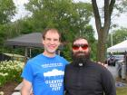 Church leader with volunteer - Glenview Greek Fest at Sts. Peter & Paul