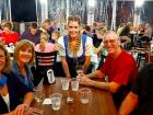 Friends with server enjoying Johnny's Kitchen & Tap Octoberfest in Glenview