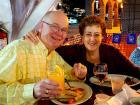 Couple enjoying Johnny's Kitchen & Tap Octoberfest in Glenview