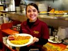 Friendly server with omelet at Annie's Pancake House in Skokie
