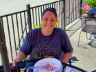 Customer enjoying lunch on the patio at Dino's Cafe in Bloomingdale
