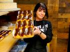 Friendly staff with chocolate eclairs at Papagalino Cafe & Pastry Shop in Niles