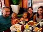 Family enjoying dinner at Rose Garden Cafe in Elk Grove Village