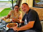 Couple enjoying outdoor lunch at Rose Garden Cafe in Elk Grove Village