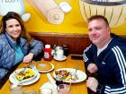 Couple enjoying breakfast at Tasty Waffle Restaurant in Romeoville