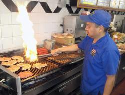 Cooking great chicken sandwiches at Charcoal Delights in Des Plaines