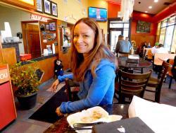 Happy customer enjoying lunch at Brandy's Gyros in Chicago