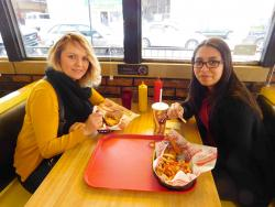 Friends enjoying lunch at Burger Baron Restaurant in Chicago