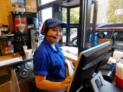 Friendly drive-thru worker at Charcoal Delights Restaurant in Chicago
