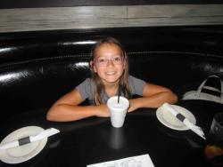 Young customer enjoying lunch with her family at Draft Picks Sports Bar in Naperville