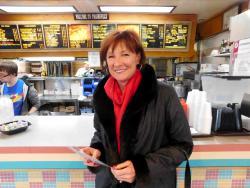 Happy customer enjoying lunch at Franksville Restaurant in Chicago