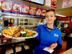 Friendly staff serving shish-ka-bob at Goodi's Restaurant in Niles