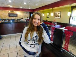 Young customer enjoying lunch at Goodi's Restaurant in Niles