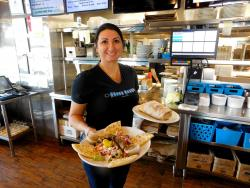 Friendly server at the Greek Feast Restaurant in Northbrook