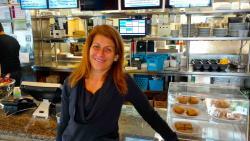 Happy customer at Greek Feast Restaurant in Northbrook