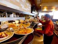 Busy wait staff serving delicious items at Kappy's American Grill in Morton Grove