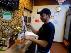 Friendly staff serving beer at Kosta's Gyros in Algonquin