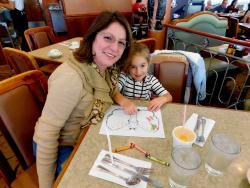 Mom and daughter enjoying breakfast at Lumes Pancake House in Orland Park