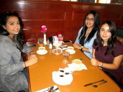 Friends enjoying breakfast at Lumes Pancake House in Palos Heights