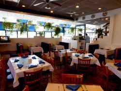 The cozy dining room at Mykonos Greek Restaurant in Niles