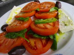Feta cheese and tomato appetizer at Mykonos Greek Restaurant in Niles