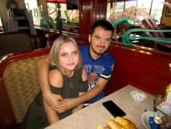 Young couple enjoying breakfast at Omega Restaurant & Pancake House in Downers Grove