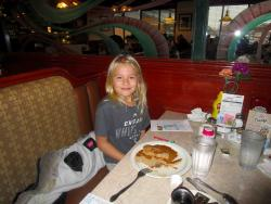 Youngster enjoying pancakes at Omega Restaurant & Pancake House in Downers Grove