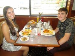 Friends enjoying lunch at Omega Restaurant & Pancake House in Schaumburg