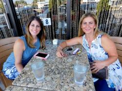 Friends enjoying the outdoor patio at Papagalino Cafe & Pastry Shop in Niles