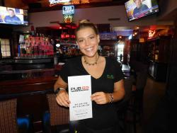 Friendly server in the spacious lounge at Pub 83 in Long Grove