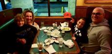 Family enjoying dinner at Andrew's Open Pit & Spirits in Park Ridge