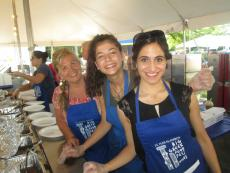 Friendly volunteers serving guests at The Big Greek Food Fest of Niles