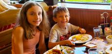 Brother and sister enjoying lunch at Billy's Pancake House in Palatine