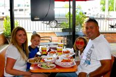 Family enjoying lunch at Brandy's Gyros in Chicago