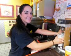 Friendly staff preparing one of Brandy's Gyros famous milkshakes