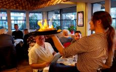 Serving the flaming Saganaki at Brousko Authentic Greek Cuisine Schaumburg