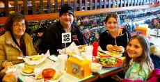 Family enjoying lunch at Burger Baron Restaurant in Arlington Heights