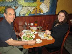 Customers enjoying chicken salad and spinach pie at Central Gyros Chicago