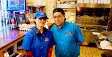Friendly kitchen staff at Charcoal Delights Restaurant in Chicago