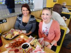 Customers enjoying delicious sandwiches at Burger Baron in Chicago