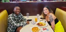 Young couple enjoying breakfast at Dino's Cafe in Bloomingdale