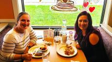 Friends enjoying breakfast at Golden Brunch Restaurant in Arlington Heights