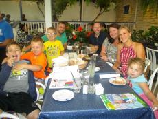 Family enjoying dinner on the patio at Mykonos Greek Restaurant in Niles