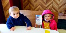 Kids ready to enjoy hot dogs at Nick's Drive-In Restaurant Chicago