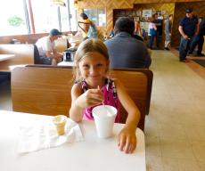 Young customer enjoying ice cream at Nick's Drive-In Restaurant Chicago