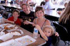 Family enjoying the Oak Lawn Greek Fest at St. Nicholas Greek Orthodox Church