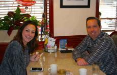 Couple enjoying breakfast at Omega Restaurant & Pancake House in Downers Grove