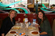 Friends enjoying breakfast at Omega Restaurant & Pancake House in Downers Grove