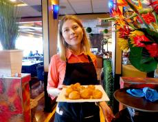 Serving the famous Loukoumades at Papagalino Cafe & Pastry Shop in Niles