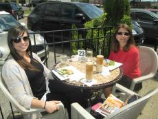 Friends enjoying the patio at Papagalino Cafe Bakery in Niles